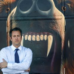 Michael Roe, principal of Poly High School, poses in front of the school mascot on Feb. 16, 2016, in the city of Riverside.