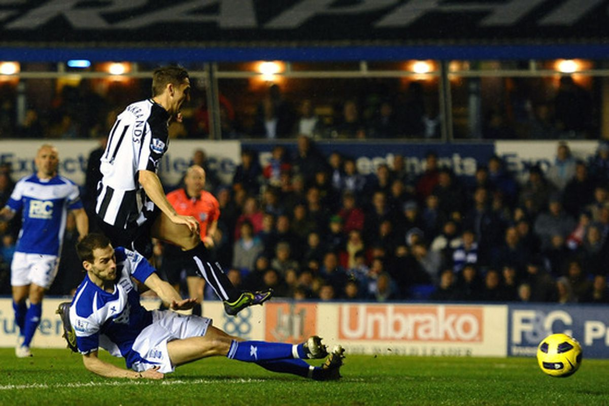 <strike>Barry Pepper</strike> Peter Lovenkrands of Newcastle scores the opening goal during the match between Birmingham City and Newcastle United.