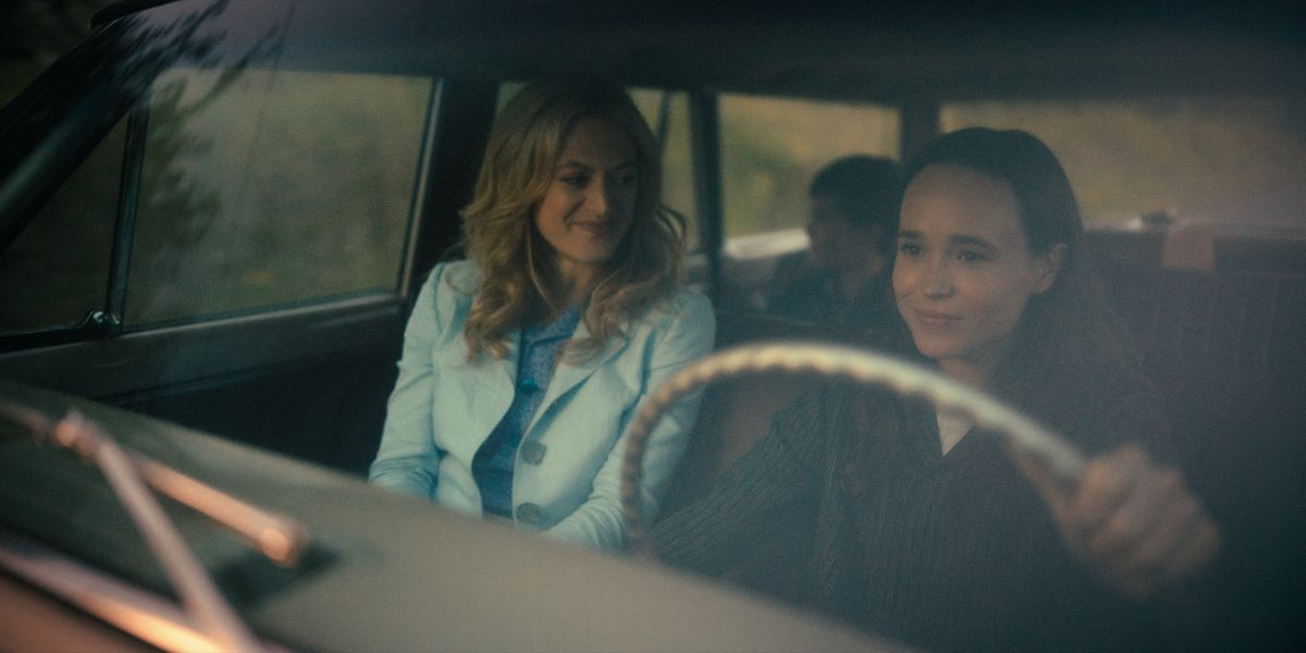 vanya sitting in a car with a pretty blonde woman