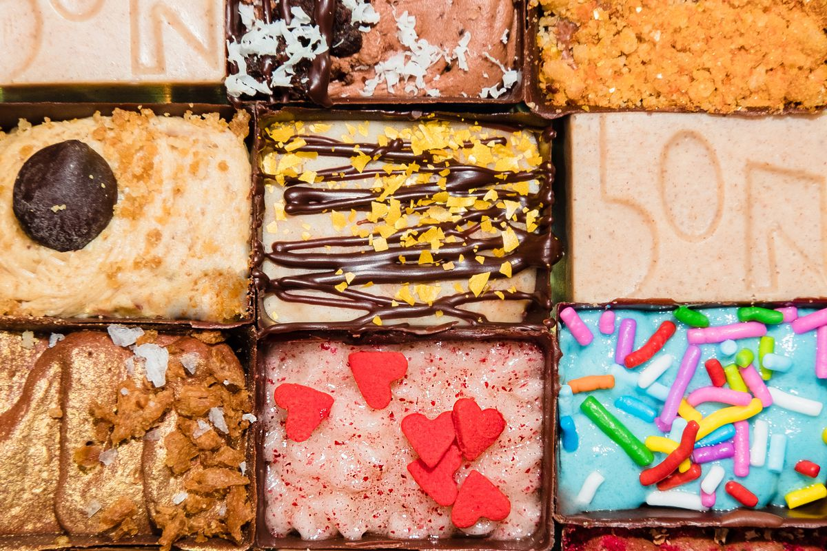 A bunch of colorful rectangular chocolate bonbons packed tightly together.