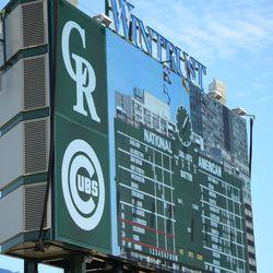 1:08 p.m. The left field video board, displaying the scoreboard -