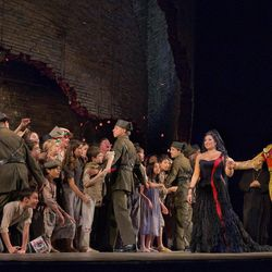 """In this Sept. 22, 2012 photo provided by the Metropolitan Opera, Kyle Ketelsen, right, performs in the role of Escamillo with Anita Rachvelishvili as the title character in Bizet's """"Carmen,"""" during a rehearsal at the Metropolitan Opera in New York."""