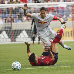 Real Salt Lake midfielder Damir Kreilach (8) and New York City Red Bull Sean Davis get tangled in Sandy on Saturday, March 7, 2020. RSL tied with New York 1-1.