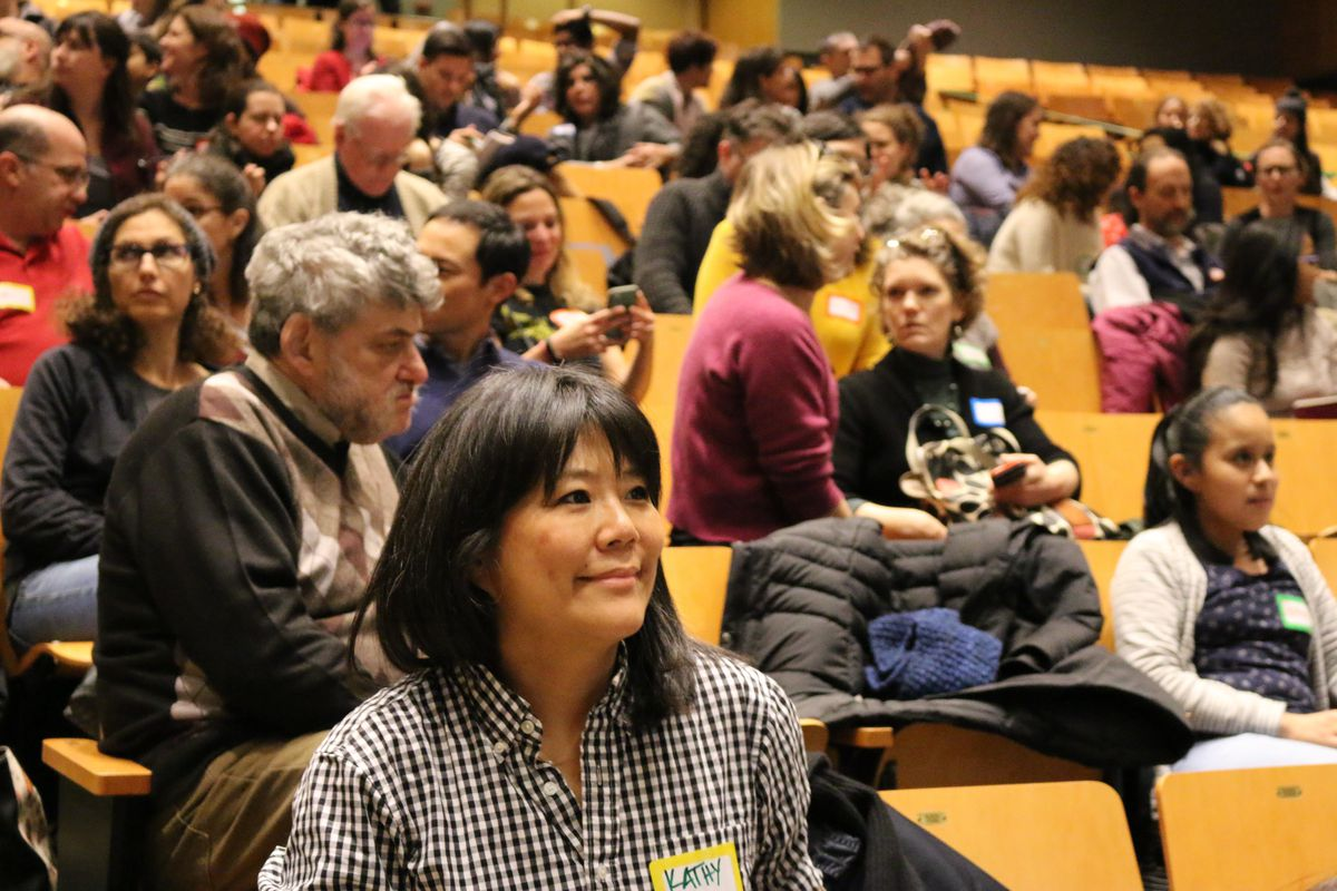 Parents attend a public meeting in Brooklyn's District 15.