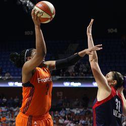 Connecticut Sun's Kelsey Bone (3) puts up a shot over Washington Mystics' Stefanie Dolson (31).