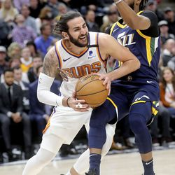 Phoenix Suns guard Ricky Rubio (11) moves around Utah Jazz guard Mike Conley (10) during an NBA game at the Vivint Smart Home Arena in Salt Lake City on Monday, Feb. 24, 2020.