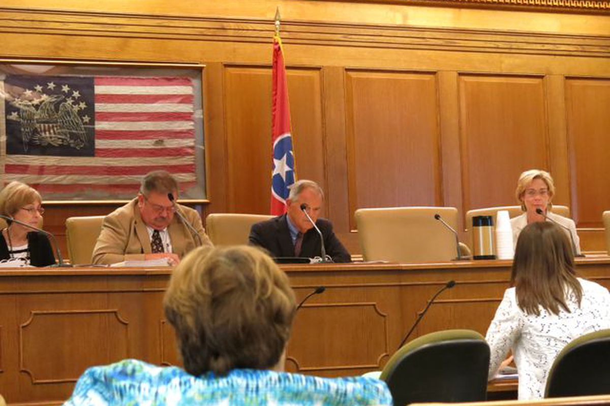 The school board observed a presentation on charter school authorization at a meeting in July.