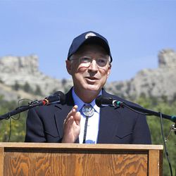 With the ridgeline of Chimney Rock behind him, U.S. Interior Secretary Ken Salaza addresses the crowd for the dedication of Chimney Rock as the newest National Monument in the nation, Friday, Sept. 21, 2012 in Pagosa Springs, Colo. (AP Photo/Shaun Stanley, Durango Herald)