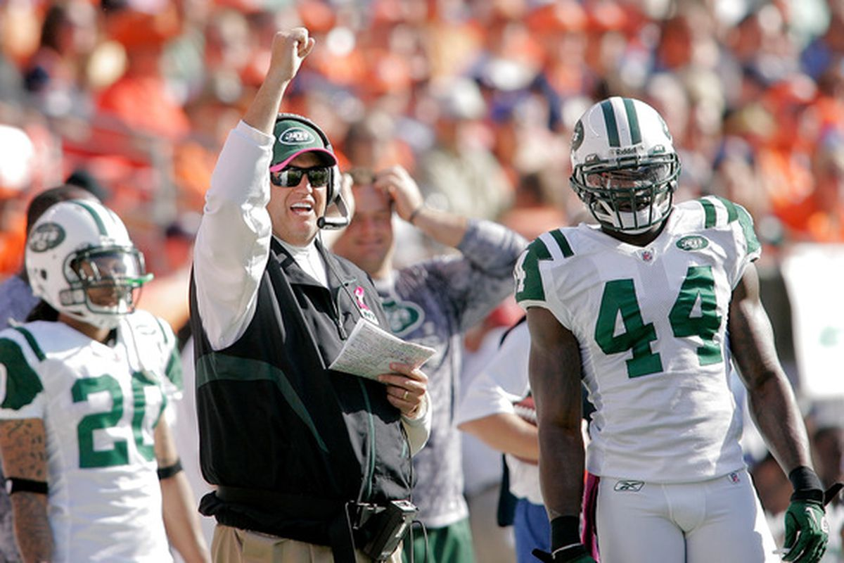 DENVER - OCTOBER 17:  Head coach Rex Ryan the New York Jets celebrates a penalty call against the Denver Broncos at INVESCO Field at Mile High on October 17 2010 in Denver Colorado.  (Photo by Justin Edmonds/Getty Images)