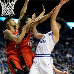 Brigham Young Cougars guard Elijah Bryant (3) is fouled by Illinois State Redbirds guard Madison Williams (25) on a shot attempt as BYU and Illinois State play in an NCAA men's basketball game in Provo on Wednesday, Dec. 6, 2017. BYU won 80-68.