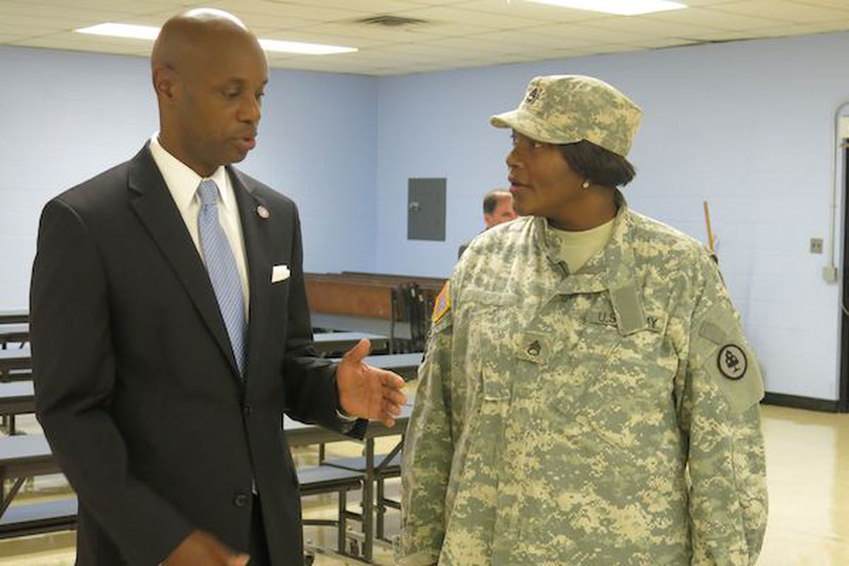 """Shelby County Schools Superintendent Dorsey Hopson II talks academic goals with Riverview K-8 principal Rosalind Martin on the first day back to school Monday.  Martin said her school's theme this year is """"Bootcamp to Improve Literacy.""""  Martin and her staff will wear their military gear each Monday during the school year."""