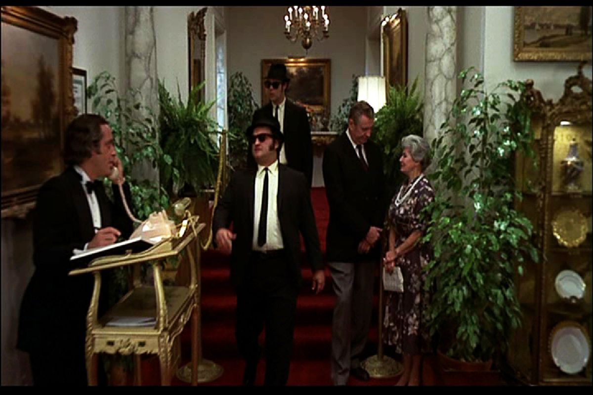 """Dan Aykroyd (background) and John Belushi arrive at the tony Chez Paul restaurant in this scene from """"The Blues Brothers."""""""