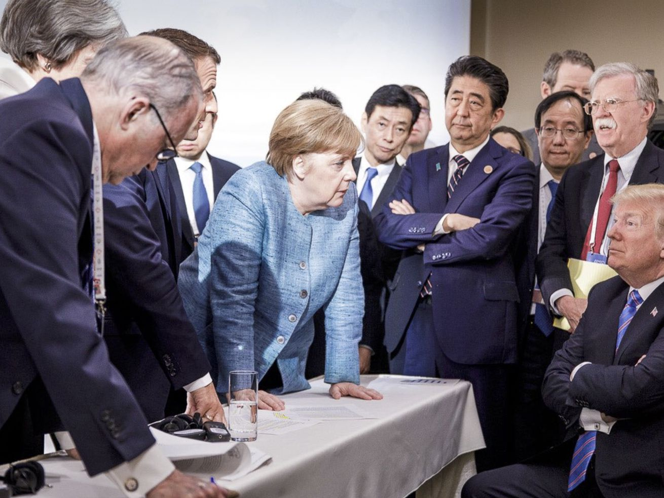 World leaders huddle at the G7 summit.