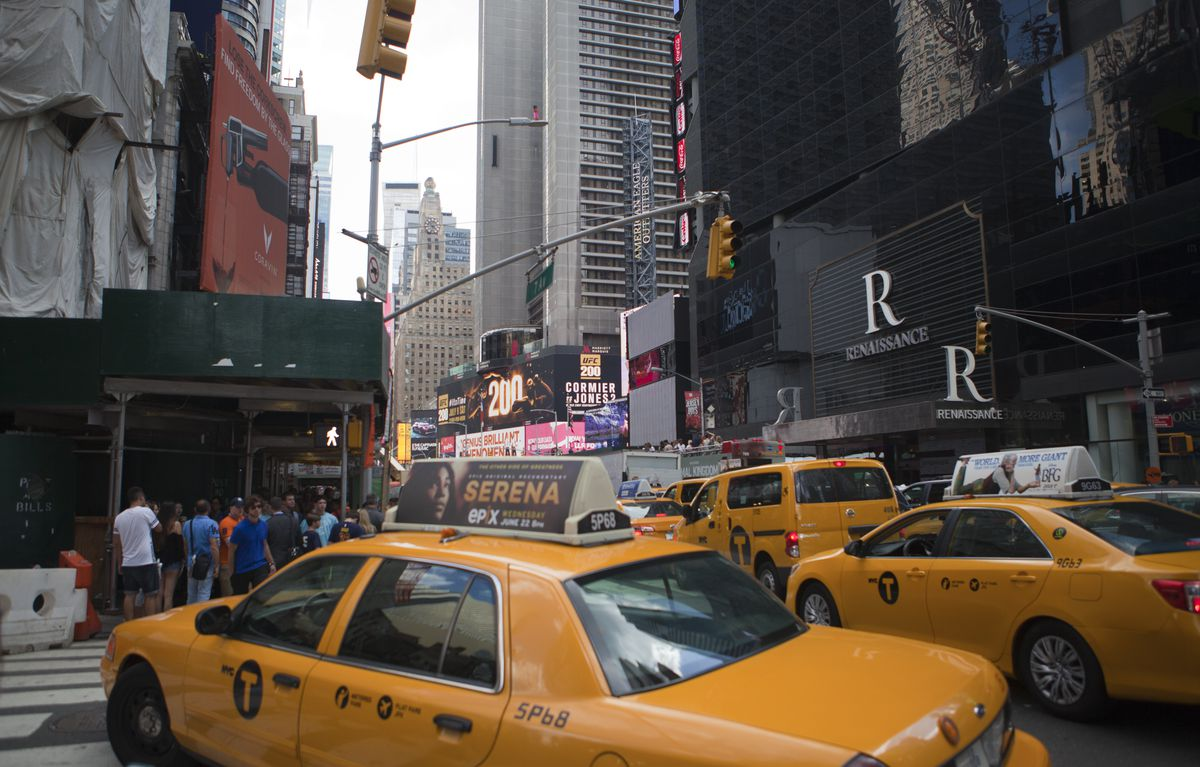 Yellow cabs drive on 7th Avenue towards Times Square in...