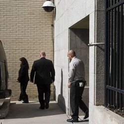 Tim DeChristopher leaves the federal courthouse in custody in Salt Lake City on Tuesday, July 26, 2011.