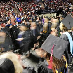 Students enter the Maverik Center in West Valley City for Salt Lake Community College's commencement ceremony on Friday, May 6, 2016.
