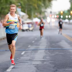 Rory Linkletter finishes first in the men's division of the Deseret News 10K at Liberty Park in Salt Lake City on Friday, July 23, 2021.