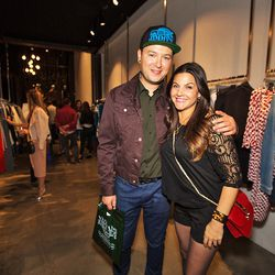 """Partygoers Vlad Galyuz and Dina Darwish. Loving Vlad's throwback <a href=""""http://la.racked.com/archives/2012/04/05/opening_ceremony_revives_80s_cult_surf_label_jimmyz.php""""target=""""_blank"""">Jimmy'Z</a> hat."""