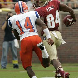 Florida State's Rodney Smith (84) looks back at Savannah State's Wayne Johnson as he breaks away to score the first touchdown in the first quarter of an NCAA college football game on Saturday, Sept. 8, 2012, in Tallahassee, Fla.