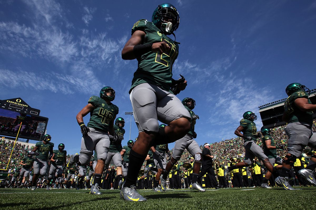 EUGENE, OR - SEPTEMBER 15:  The Oregon Ducks run onto the field against of the Tennessee Tech Golden Eagles on September 15, 2012 at the Autzen Stadium in Eugene, Oregon.  (Photo by Jonathan Ferrey/Getty Images)