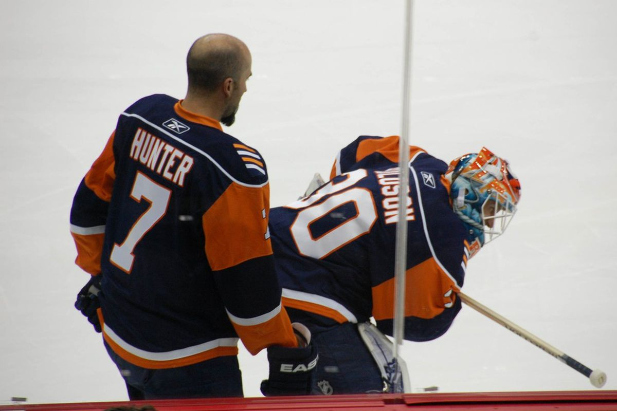 <em>Trent Hunter attends to Dwayne Roloson after tagging him with a high shot in warmups. Imagined sources indicate Hunter feel shame.</em>      Photo courtesy of Dominik's camera.
