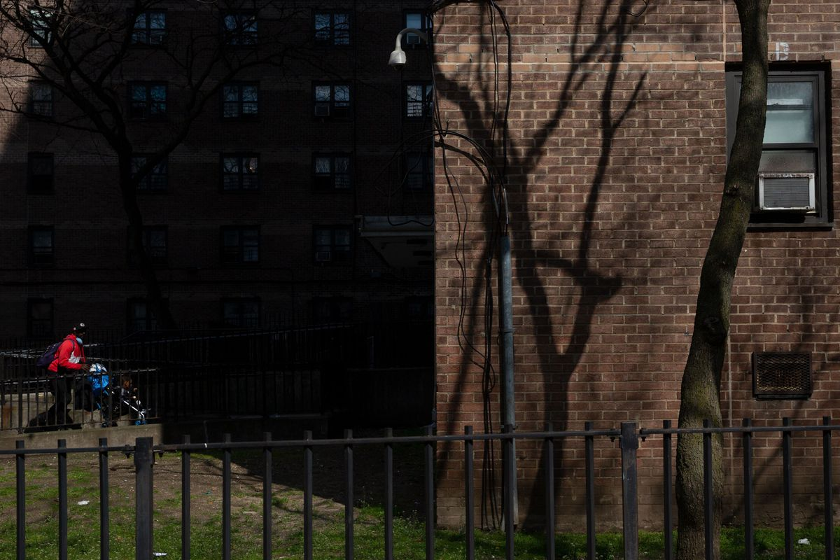 A Marcy Houses resident in Brooklyn pushes their child in a stroller, April 8, 2020.