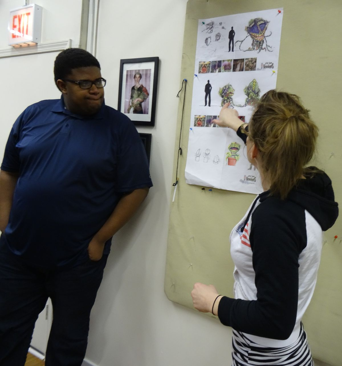 """Lorenzo Rush Jr. (the voice of Audrey II), chats with puppet designer Sarah Ross about American Blues Theater's production of """"Little Shop of Horrors."""" (Photo: Courtesy of American Blues Theater)"""