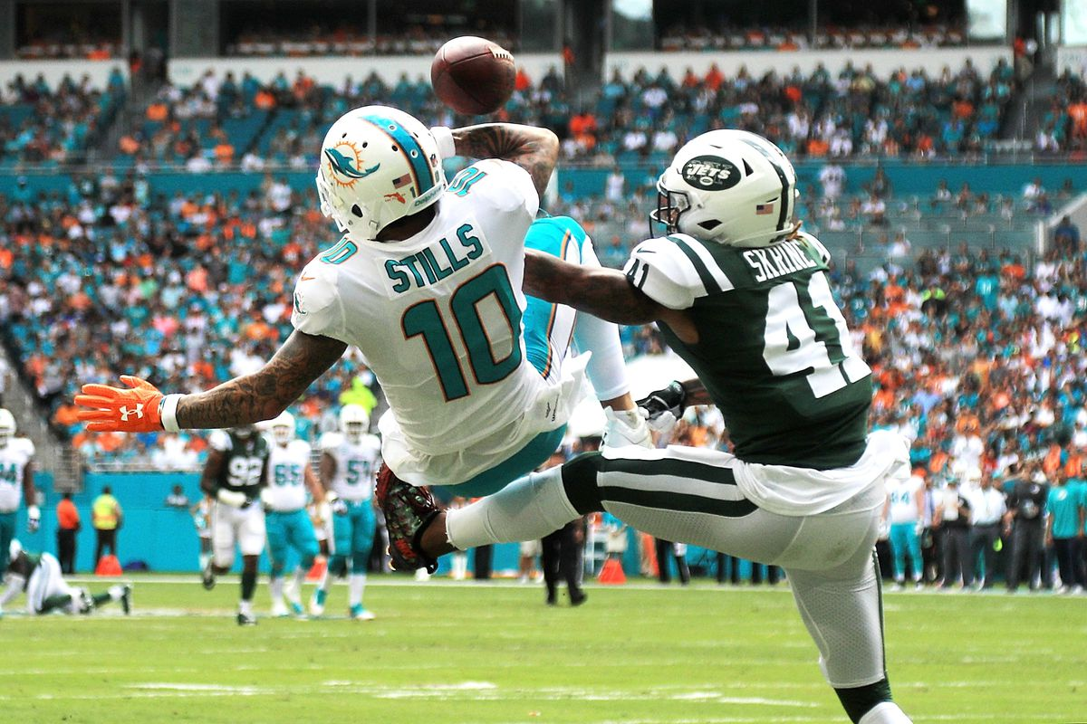 Kenny Stills attempting a catch while falling backward