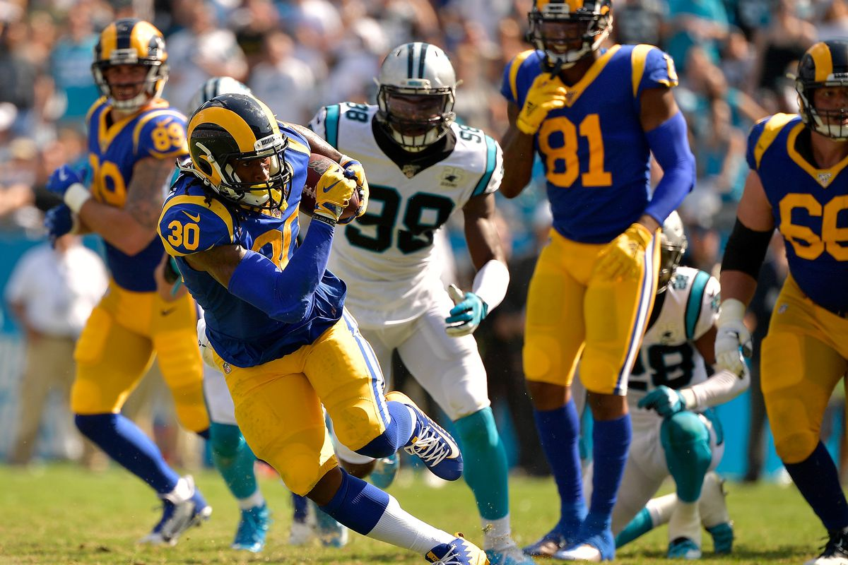 Todd Gurley of the Los Angeles Rams breaks through the Carolina Panthers defense for a first down during the fourth quarter of their game at Bank of America Stadium on September 08, 2019 in Charlotte, North Carolina.