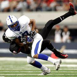 Bingham's Josh Smith is tackled by Trinity's Sam Smith as the Miners play Euless (Texas) Trinity Monday in the Kirk Herbstreit Varsity Football Series at Dallas Cowboys Stadium in Arlington, Texas. Trinity won 42-21.