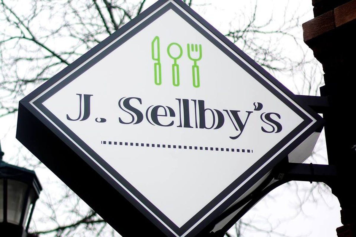 The white sign of J. Selby's