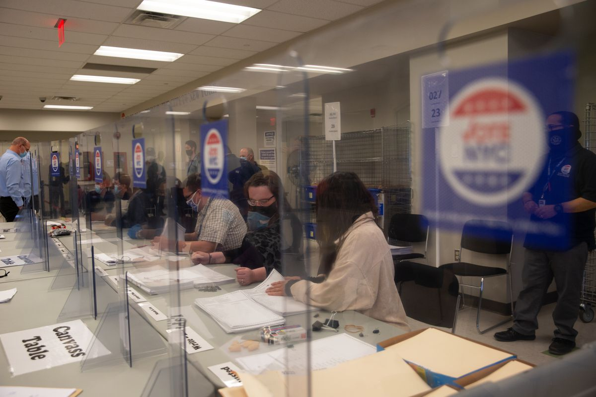 Board of Elections workers tally ballots for the Council District 31 special election in Queens, March 16, 2021.