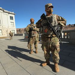 Members of the Utah National Guard, who wished to remain unidentified, patrol the Capitol grounds in Salt Lake City as the Utah Legislature opens the 2021 general session on Tuesday, Jan. 19, 2021.