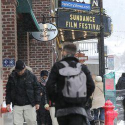 People walk the sidewalks on Main Street in Park City as they attend Sundance on Sunday, Jan., 22, 2017.