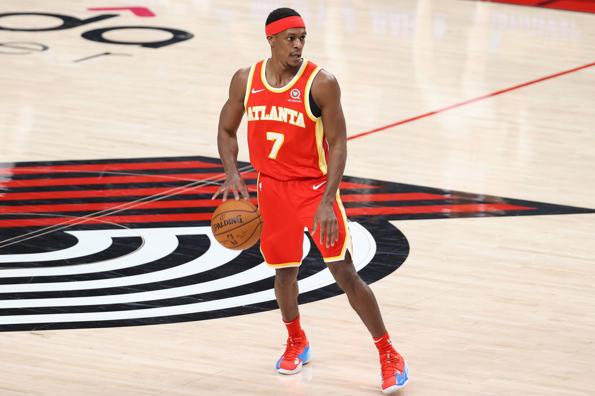 Rajon Rondo of the Atlanta Hawks dribbles with the ball in the second quarter against the Portland Trail Blazers at Moda Center on January 16, 2021 in Portland, Oregon.