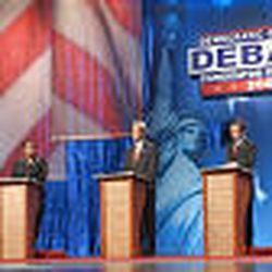 Democratic presidential candidates, from left, Sen. Bob Graham, D-Fla.; Rep. Dick Gephardt, D-Mo.; former Illinois Sen. Carol Mosley Braun; Sen. John Kerry, D-Mass.; Rep. Dennis Kucinich, D-Ohio; Sen. John Edwards, D-N.C.; Sen. Joe Lieberman, D-Conn.; and Vermont Gov. Howard Dean take turns Thursday during their first nationally televised debate, held in Albuquerque, N.M. Few sparks flew at the debate, despite predictions of a showdown between Dean and Kerry, who are considered the front-runners.