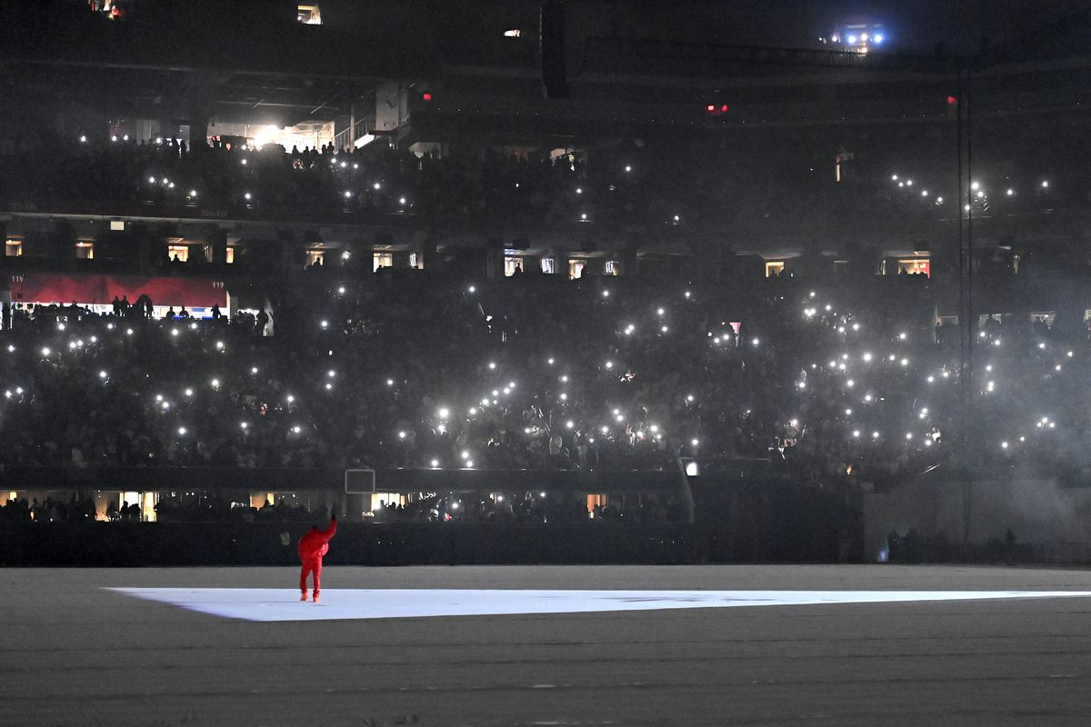 """Kanye West waves to the audience during his """"Donda"""" listening event Friday at Mercedes-Benz Stadium in Atlanta."""