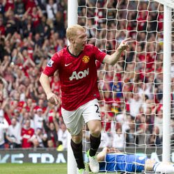 Manchester United's Paul Scholes celebrates after scoring against Wigan Athletic during their English Premier League soccer match at Old Trafford Stadium, Manchester, England, Saturday, Sept. 15, 2012.
