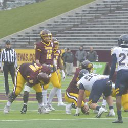 Kahlil Robinson waits for the play to begin as Quinten Dormady scans the defense prior to the snap.