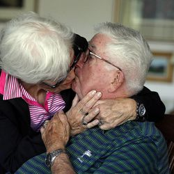 Frank and Barbara Layden kiss after posing for a portrait at their home in Salt Lake City Tuesday, June 3, 2014.