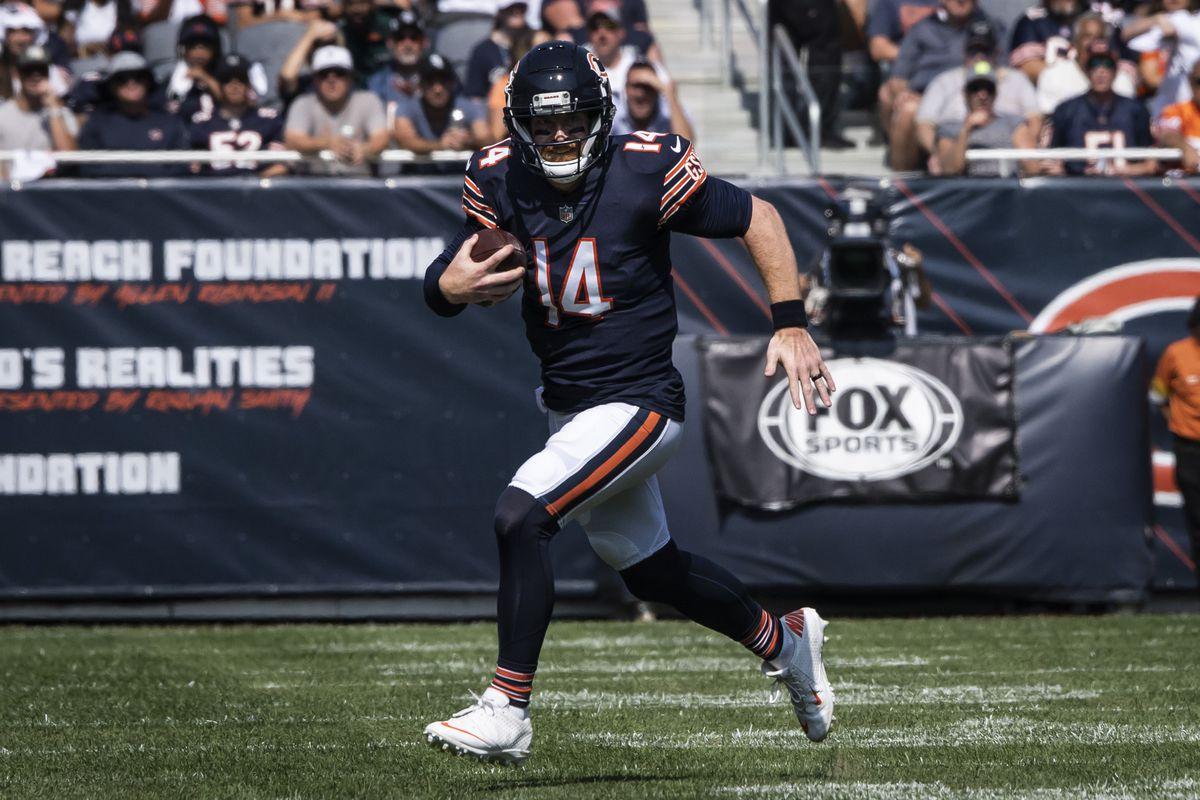 Bears quarterback Andy Dalton scrambles against the Bengals on Sunday.