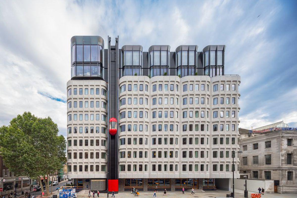 Brutalist building with red elevator