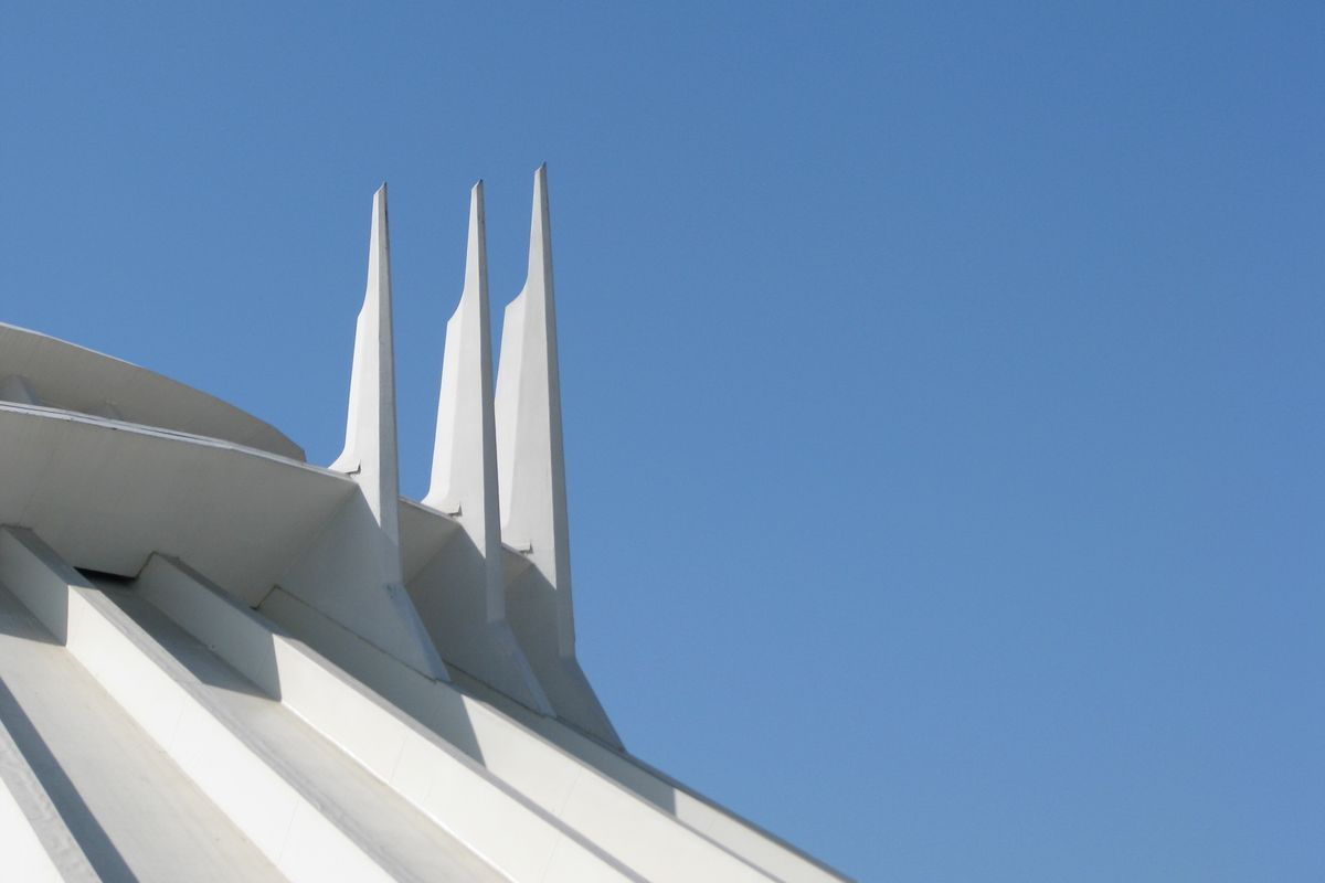View of Space Mountain's roofline against a blue sky