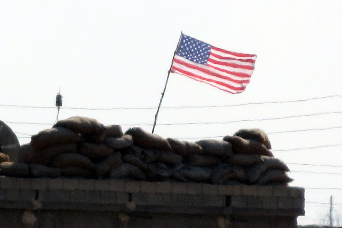 An American flag hangs on a building in Raqqa, Syria in September 2016.