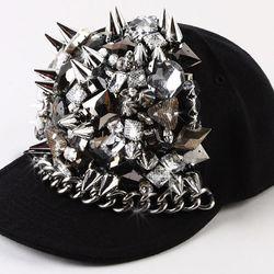 "<b>Deryk Todd</b> Diamond Dogs Hat in black, <a href=""http://www.patriciafield.com/diamond-dogs-hat.aspx"">$276</a> at Patricia Field"