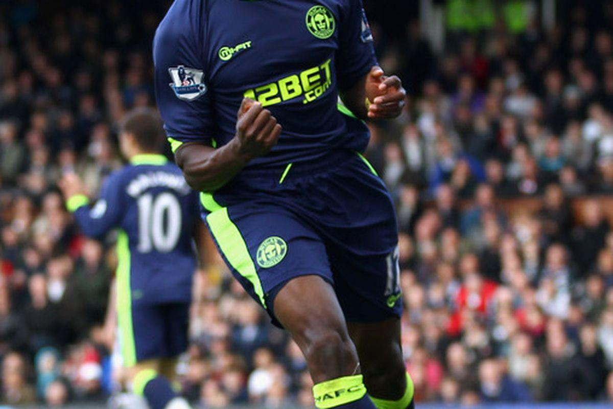 Emmerson Boyce of Wigan Athletic celebrates scoring his side's first goal during the Barclays Premier League match between Fulham and Wigan Athletic at Craven Cottage.