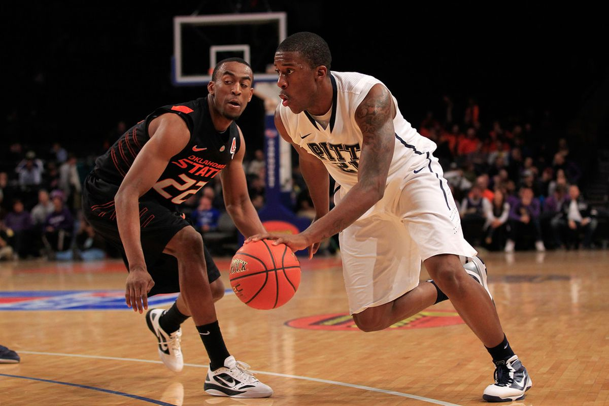 NEW YORK, NY - DECEMBER 10: Lamar Patterson #21 of the Pittsburgh Panthers dribbles past Markel Brown #22 of the Oklahoma State Cowboys at Madison Square Garden on December 10, 2011 in New York City.  (Photo by Chris Trotman/Getty Images)