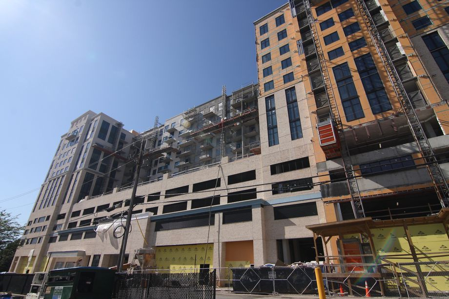A building that's under construction against a blue sky.