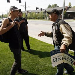 A member of a coalition of activists, left, confronts a Mitt Romney supporter, right, outside the Grand America Hotel as Mitt Romney visits Salt Lake City, Tuesday, Sept. 18, 2012.