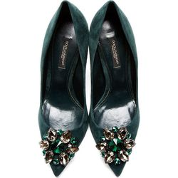 """<b>Dolce & Gabbana</b>, <a href=""""https://www.ssense.com/women/product/dolce_and_gabbana/green-crystal-accent-suede-pumps/109448"""">$528</a> (from $880)"""